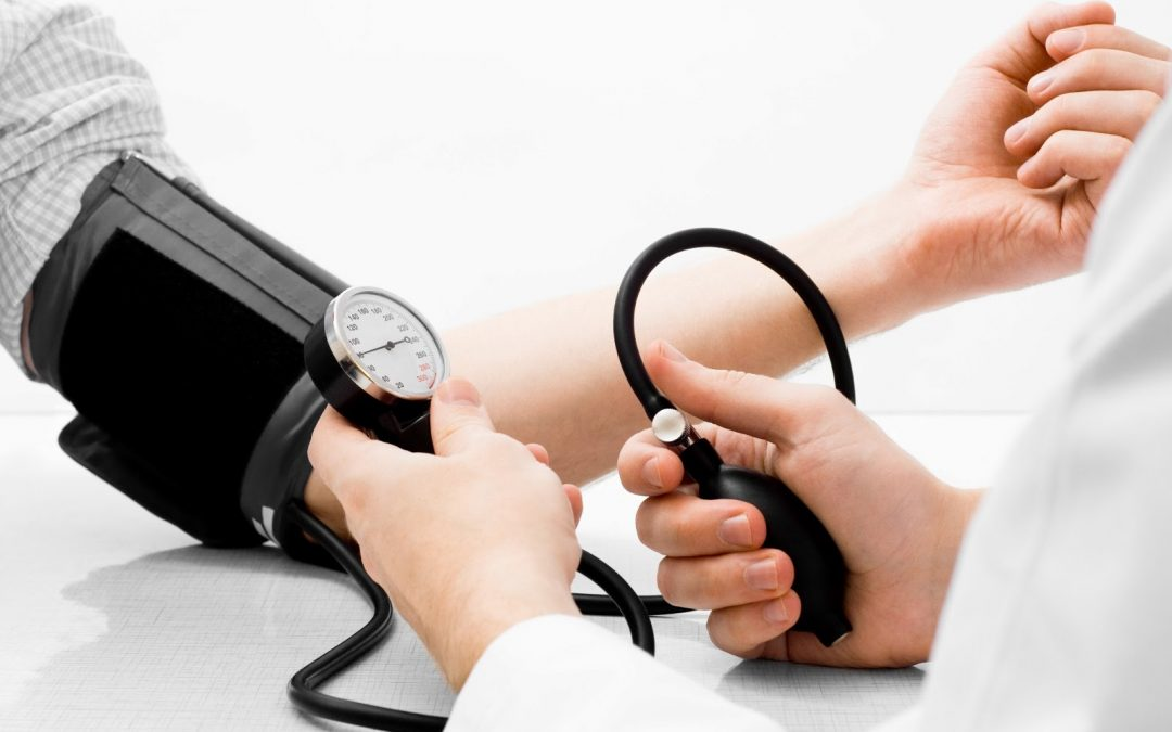 A doctor takes blood pressure