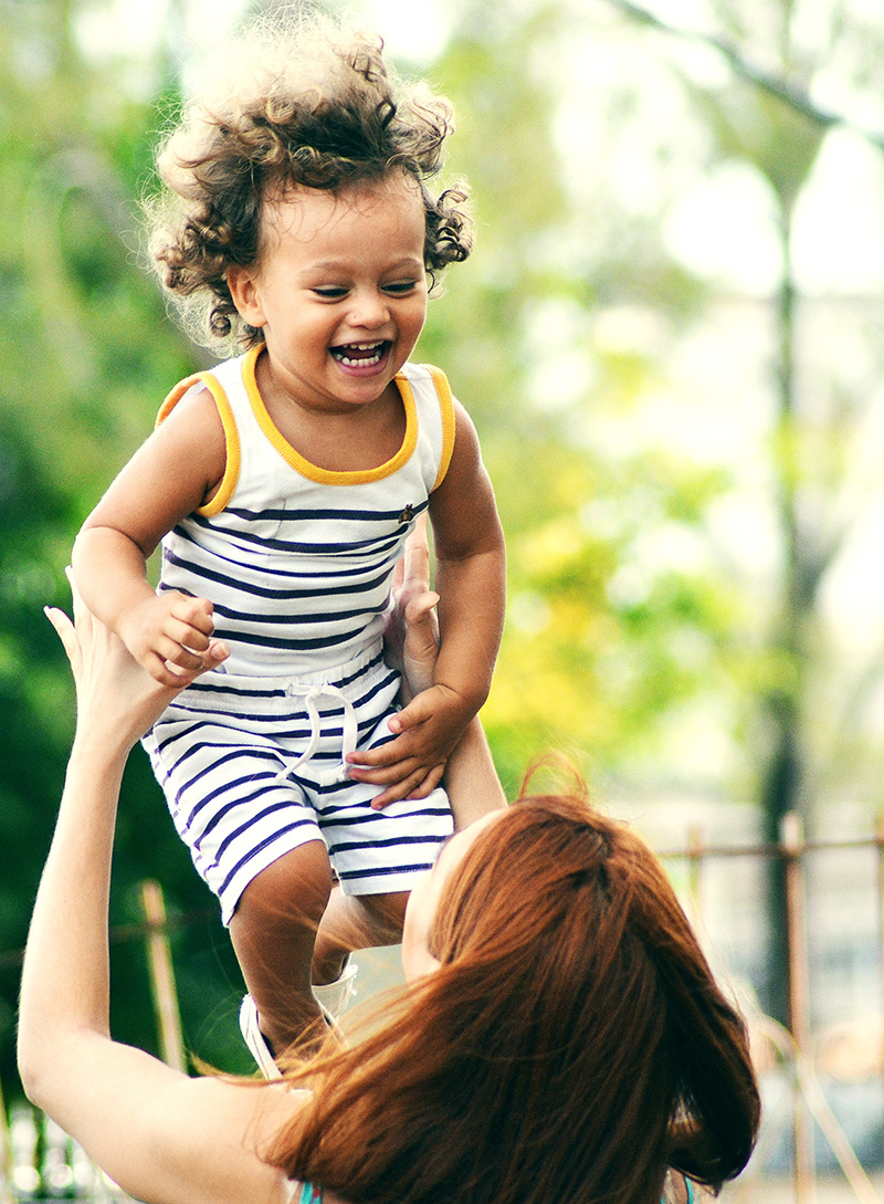 woman catching a smiling child